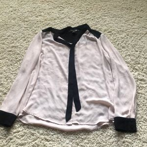 Nude and black blouse